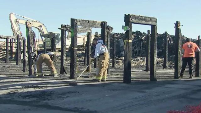 Crews clean up after a fire that killed two women in a condominium complex at Carolina Beach