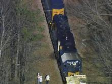 A CSX train caught fire and came to a stop late Friday morning near downtown Wake Forest, officials said.