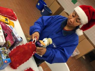 Volunteers sort gifts at the Salvation Army warehouse in Raleigh before they are distributed to needy families.