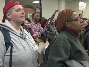 "Singing and chanting ""black lives matter,"" a group of protesters interrupted a Durham City Council meeting Thursday to vocalize their feelings about race relations and recent tensions between residents and law enforcement."