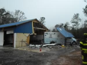 A Moore County ambulance crashed into a building in Carthage during heavy rain Wednesday, authorities said. Photo courtesy of Aberdeen Times.