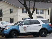 A police vehicle sits outside Arbor Creek Apartments off Buck Jones Road in Raleigh on Dec. 25, 2014, as authorities investigate the death of 2-year-old Tristan Matthew Blue. His parents have been charged in the case.