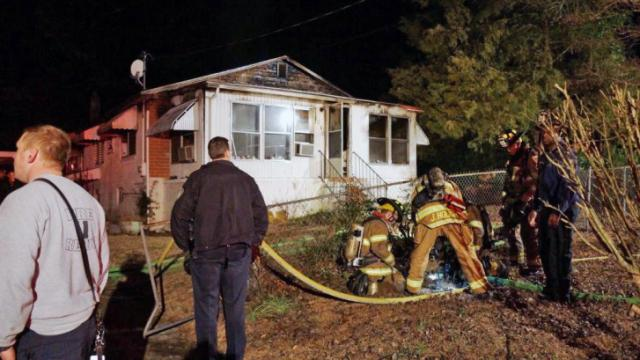 A 70-year-old Southern Pines woman died late Friday after a home in the 800 block of West New Hampshire Avenue caught fire, officials said.