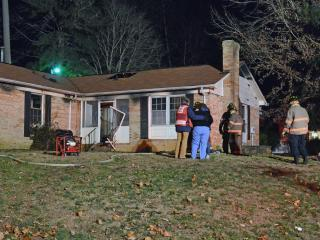 Emergency responders in Durham rescued two dogs from a home Wednesday evening after a space heater sparked a fire.