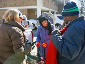Volunteers from the Raleigh Rescue Mission handed out hats, gloves, jackets and scarves on Thursday, Jan. 8, 2014, to help those in need battle cold temperatures.