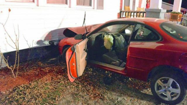 A 24-year-old was charged with DWI and reckless driving early Saturday after crashing his car into a 100-year-home in Johnston County.