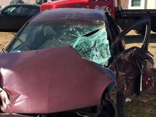 Katie Bennett is lucky to have survived a crash that left her Dodge Neon crumpled and crushed.