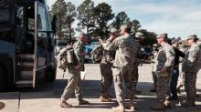 IMAGES: Bragg soldiers who fought Ebola return home following medical quarantine