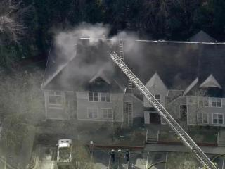 Firefighters respond Jan. 29, 2015, to a fire at Palmer Street Apartments in Durham.