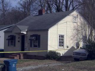 Durham police investigate the deaths of two people in a home at 520 Spruce St. on Feb. 4, 2015.