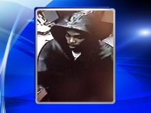 A surveillance photo from Dec. 21, 2014, shows a robbery suspect at the Payless Shoes location at 4501 New Bern Avenue.