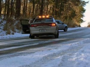 A state trooper battles icy conditions in north Raleigh on Feb. 19, 2015.