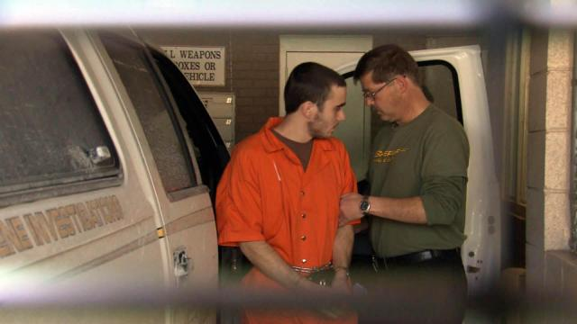 Eric Alexander Campbell, who is charged in the Jan. 1, 2015, deaths of a Granville County couple, arrives at the county jail on Feb. 19, 2015, from West Virginia, where he and his father were arrested after a shootout with police.