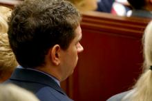 Nation Hahn listens to opening statements March 4, 2015, in the first-degree murder trial of Jonathan Broyhill, accused of killing Hahn's wife, Jamie Kirk Hahn, in April 2013.