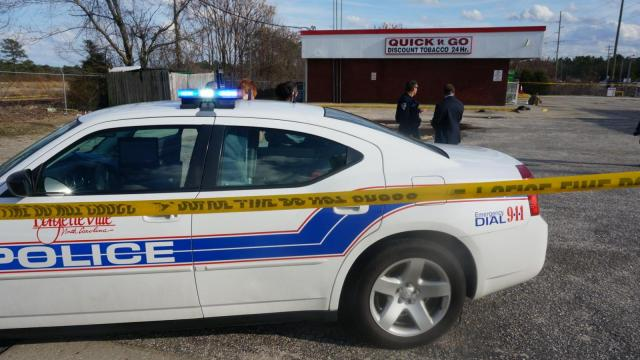 One person was shot in the arm behind Quick-n-Go Discount Tobacco, 5320 Murchison Road in Fayetteville, Wednesday afternoon. (Michael Joyner/WRAL)