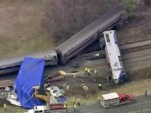 An Amtrak train traveling from Charlotte to New York derailed in Halifax County after colliding with a tractor-trailer at an intersection, authorities said. (March 9, 2015)