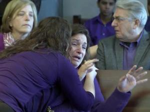 Christine Perolini is comforted by a friend on March 11, 2015, as a jury acquits her ex-husband in the strangulation death of their 4-year-old son in their Durham County home in September 2010. The defense claimed he was sleepwalking at the time the boy was killed.