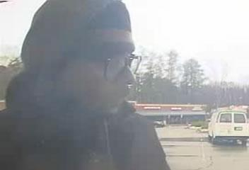 Cary police are looking for this man, captured on ATM security video, in connection with recent cases of suspected credit card cloning.