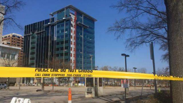 Crime scene tape surrounds the Charter Square building, under construction on Fayetteville Street in downtown Raleigh, after three people died and a fourth seriously injured March 23, 2015, during a construction accident.