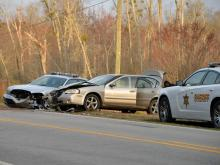 A North Carolina State Highway Patrol trooper was involved in a wreck with another car early Wednesday on Covered Bridge Road in Clayton.