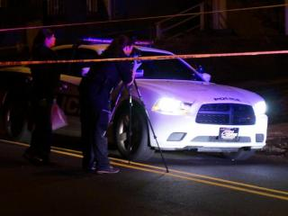 An 11-year-old boy was shot while walking in the 300 block of North Hyde Park Avenue Friday night, according to authorities.