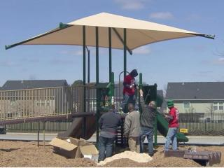 A Knightdale preschool won a $15,000 construction grant that was used to build a community playground Saturday.