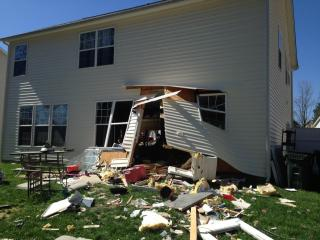 A car crashed through a home in Creedmoor on Tuesday morning before coming to a stop in the backyard, police said.