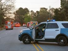 Authorities blocked a portion of Poole Road at Beverly Drive in east Raleigh early Wednesday due to a house fire.