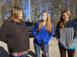 Aubrey and Kelsey Fletcher speak with the media after returning home Wednesday, April 1, 2015. The sisters got lost in the woods near their Durham County home on Tuesday.