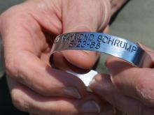Strangers bond through POW bracelet