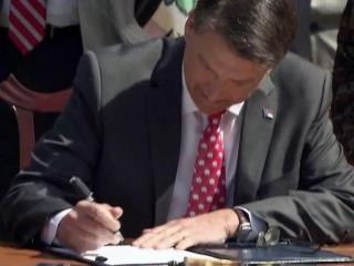Gov. Pat McCrory signs a bill on April 2, 2015, that allows the N.C. Eastern Municipal Power Agency to issue refinance debt and pass the cost savings to electric customers in 32 cities and towns in eastern North Carolina.