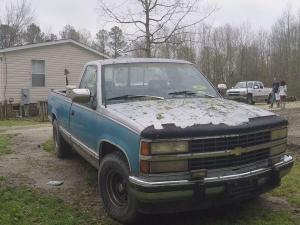 Hail damage is evident on the Denton's pickup truck.