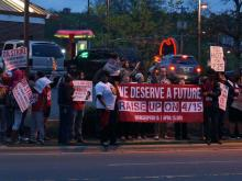Dozens of fast-food workers rallied on North Roxboro Street in Durham early Wednesday as part of the latest protest to push companies to pay their employees at least $15 an hour.