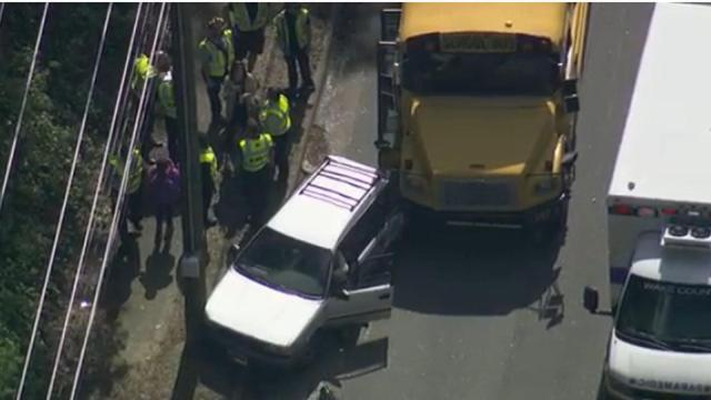 Eight students were taken to a hospital Tuesday afternoon after a Wake County school bus and a car collided on Wade Avenue in Raleigh.