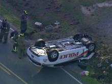 Sky 5 video: Police car flipped over in Johnston County