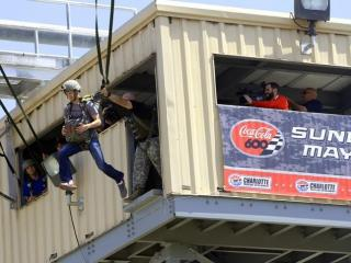 NASCAR driver Kasey Kahne jumps from a training tower at Fort Bragg on Thursday during his day at the post.  The event was a promotion for the Coca-Cola 600, (Photo courtesy of Charlotte Motor Speedway.)