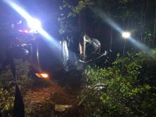 Two people died and a third person was injured on April 24, 2015, after a car crashed into a tree during a police chase in Moore County, authorities said.