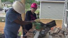 IMAGE: Habitat for Humanity volunteer helps local families with housing needs