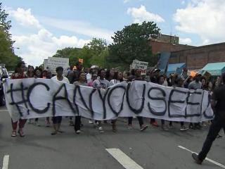 About 200 people held signs and chanted as they peacefully marched through the streets of Chapel Hill on May 2, 2015 in support of Baltimore protesters angered by the death of a black man in police custody.