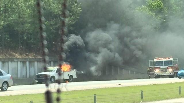 Traffic backed up after pickup truck caught fire Saturday afternoon on eastbound Interstate 540 in Raleigh.