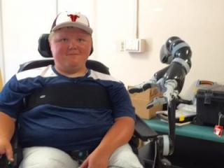 Six years ago, 15-year-old Kelby Oakley was playing basketball with his friends. Today, he can't open a door or pick up a glass of water. But a robotic arm is helping the Caswell County teen get a second chance at independence.