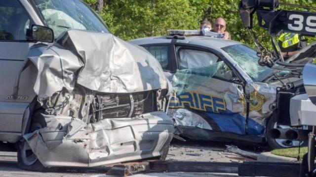 An on-duty Hoke County deputy was injured in a May 29, 2015, crash on Raeford Road at Laneridge Way in Fayetteville. (Photo courtesy of Fayetteville Observer)