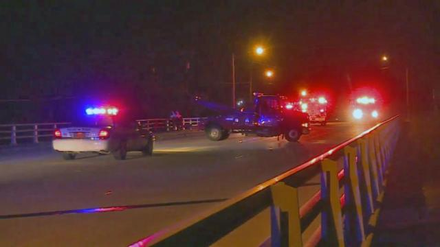 Several cars were damaged early Friday after a car hit a portion of a bridge over the All American Freeway in Fayetteville and sent debris onto the highway below.