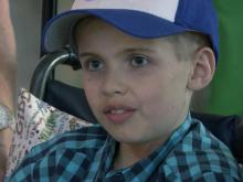 Asheville boy battling cancer gets hero's welcome at RDU