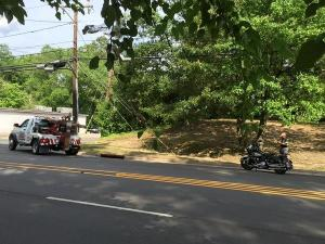 A Durham police officer was injured Friday afternoon when his motorcycle was struck by a car, police said.