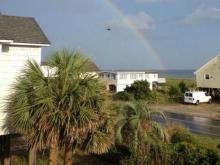 A helicopter patrolled Oak Island after two teens were bitten by a shark on Sunday June, 14, 2015.