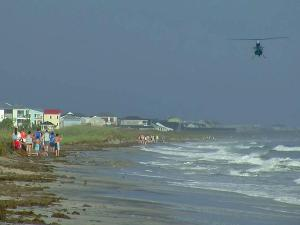 Two teens were injured Sunday in separate shark attacks on Oak Island, according to Mayor Betty Wallace.