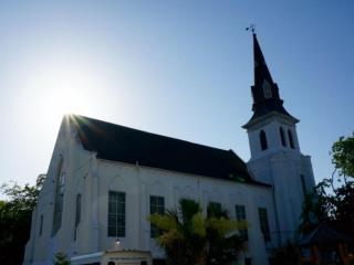 Emmanuel AME Church in Charleston, S.C., held its first worship service Sunday since a gunman fatally shot nine parishioners during Bible Study on Wednesday.