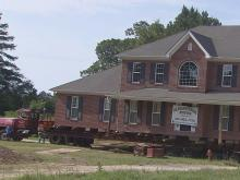 A 3,300-square foot house was moved Thursday from one side of N.C. Highway 87 in Cameron to the other.
