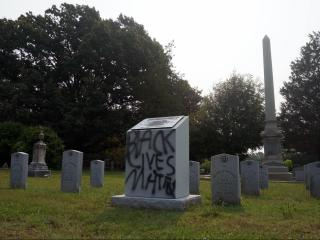 Vandals spray-painted a Confederate memorial in Maplewood Cemetery in Durham on July 1, 2015.